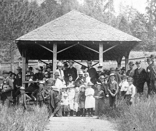Crowd of about 30 people under a gazebo in 1880 in Sodaville.