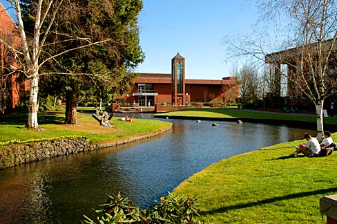 Willamette University building with stream running in front.