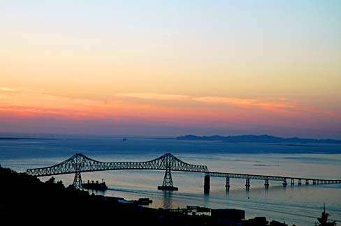 Bridge over Columbia River at sunset.