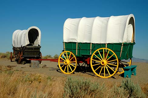 2 replica covered wagons outside on display.