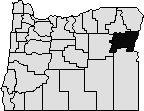 Map of Oregon with Baker county blacked out in the northeast side.
