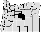 Map of Oregon with center area blacked out to indicate Crook County.