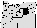 Map of Oregon with section in eastern section blacked out to indicate Grant County.