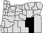 Map of Oregon with section in south eastern area blacked out to represent Harney County.