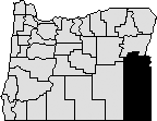 Outline of State of Oregon with southeastern corner blocked out to indicate Malheur County.