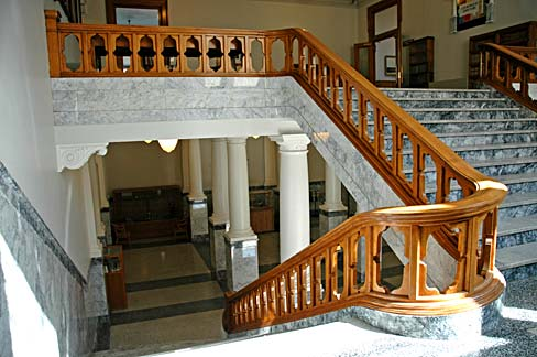 Marble staircase with wood railing in Wasco courthouse.
