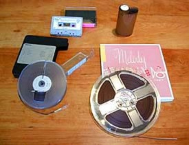 Several forms of audio storage shown such as cassette tapes and dictation tape from the 1960s.