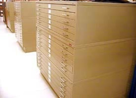 Metal cases with long, thin drawers, 15 drawers high, hold maps and architectural plans.
