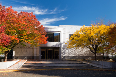 Oregon State Archives building surrounded by yellow and red autumn trees