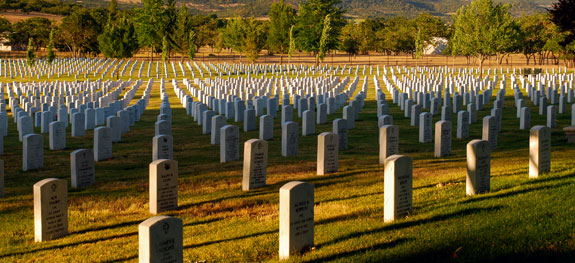 Hundreds of headstones marking graves in a cemetery.