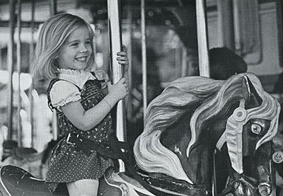 A girl rides the merry-go-round