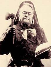 photograph of Carrie Nation holding a hatchet in one hand and the Bible in the other