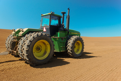 tractor in recently plowed field
