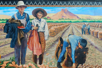 mural of Japanese Americans in fields