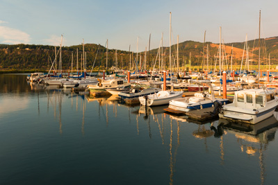 Approximately 30 personal boats docked at a marina.
