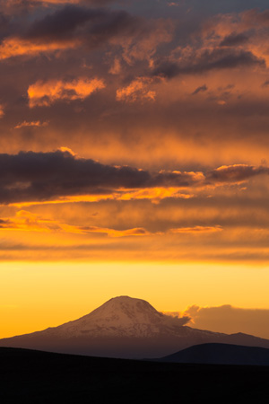 Mountain with yellow and orange sunset