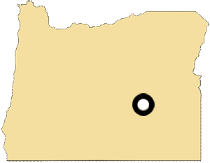 Oregon map with black and white circles indicating the location of the Burn Paiute Reservation