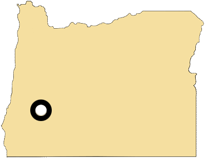 Oregon map with black and white circles documenting location of the Cow Creek Band