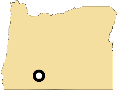 Oregon map with black and white circles documenting location of the Klamath Tribe
