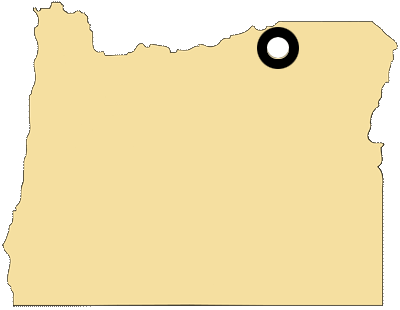 Oregon map with black and white circles documenting location of the confederated tribes of the Umatilla Indian Reservation