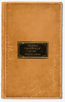 "Leather cover with the title ""Original Constitution of the State of Oregon"" printed on the front."
