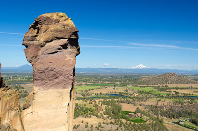 rock formation at Smith Rock State Park with river and mountain in background