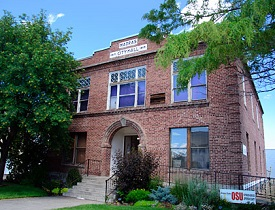 Madras City hall, a 2 story brick building.