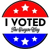 "Circle with red top, blue bottom white stars and the words ""I voted The Oregon Way"""